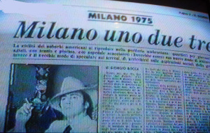 L'immagine qui riportata è falsa; è l'immagine di un Berlusconi stile mafioso,sostituita al posto di quella di un'immagine di un paesaggio della periferia milanese. Cfr., con quella vera qui sopra dell'articolo di giornale